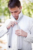 Business man making his tie — Stock Photo