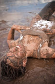 Woman in the mud — Stock Photo