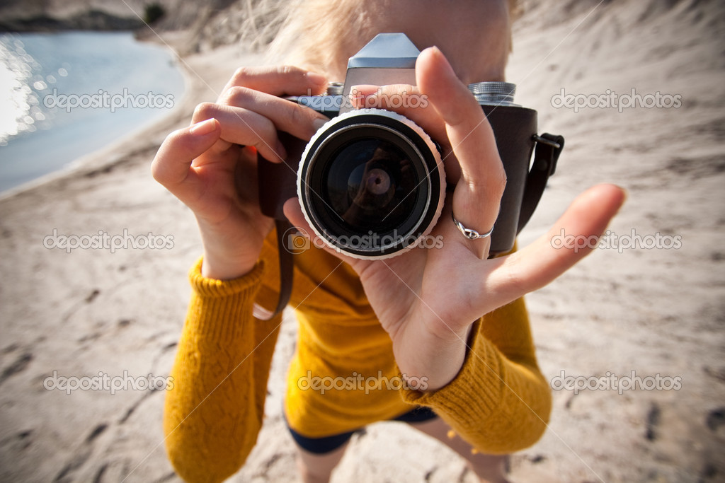 Woman with a old camera taking photos in the desert  Stock Photo #2494806
