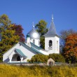 Church in the autumn - Stock Photo