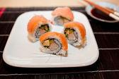 Futomaki with smoked salmon outside — Stock Photo