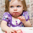 Young child celebrating her first birthday - Stock Photo