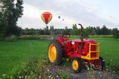 Hot Air Balloons and Tractor — Stock Photo