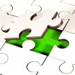 Adding Piece To Jigsaw - Stock Photo