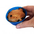 Stock Photo: Holding muffin