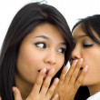 Two young asian friends gossip — Stockfoto