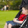 Boy in baby buggy — Stock Photo #2495936