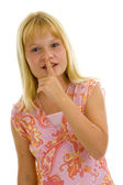 Girl with finger on her lips — Stock Photo