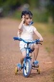 Pretty thai-indian girl on her bike — Stock Photo