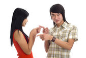Asians pointing at each others — Stock Photo