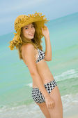 Blond teenager at the beach — Stock Photo