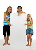 Three young females with white board — Stock Photo