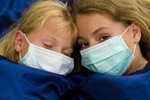 Two girls sick in bed — Stock Photo