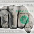 Fist with one us dollar — Stock Photo