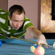 Stock Photo: Caucasimplaying pool