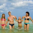 Stock Photo: Family having fun at the beach