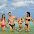 Family having fun at the beach — Stock Photo #2506672