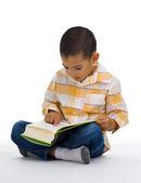 Cute boy reading  book — Stock Photo