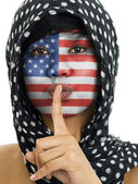 Woman with finger on lips — Stock Photo