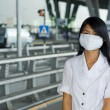 Woman with mask at the airport — Stock Photo