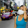 With face mask in bangkok - Stock Photo