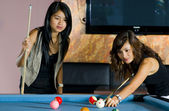 Women playing pool — Stock Photo