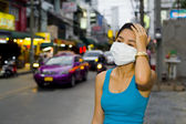 With face mask in bangkok — Stock Photo