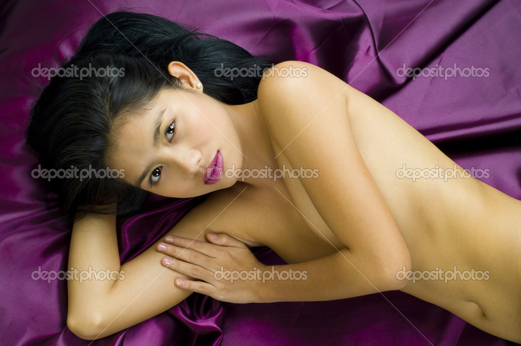 Attractive young asian woman posing nude