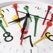 Clock and Golf Tees — Stock Photo