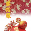 Fire Crackers and Peach on Red Packet — Stock Photo