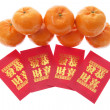 Mandarins and Red Packets — Stock Photo