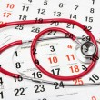 Calendar Pages and Stethoscope — Stock Photo