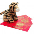 Soft Toy Tiger with Red Packets — Stock Photo #2498909