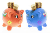 Piggy Banks with Coins — Stock Photo