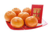Mandarin and Red Packet — Stock Photo