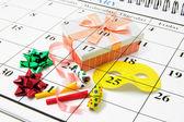 Kalendář a party laskavosti — Stock fotografie