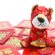 Stock Photo: Tiger Soft Toy and Red Envelopes