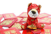 Tiger Soft Toy and Red Envelopes — Stock Photo