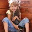 Young girl playing with cats — Stock Photo