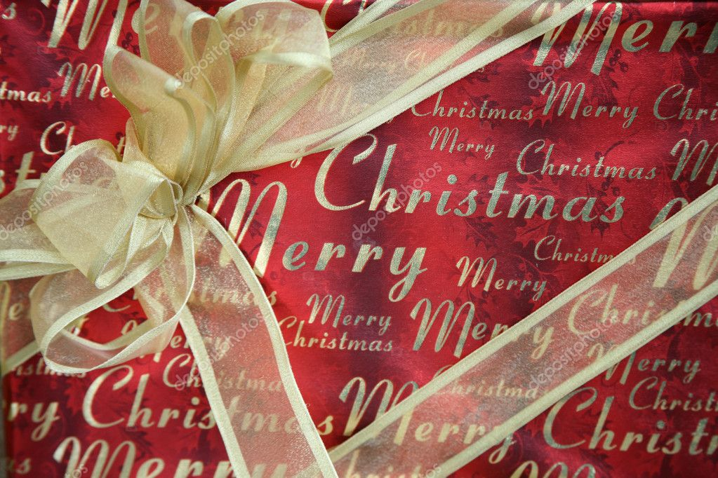 Merry Christmas Wrapped Gift with Gold Bow — Stock Photo #2553409