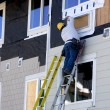 Stock Photo: MHanging Siding - Construction