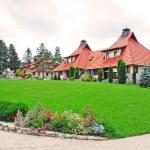 Cottage village - lawn — Stock Photo