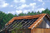Old demolished tiled roof — Stock Photo