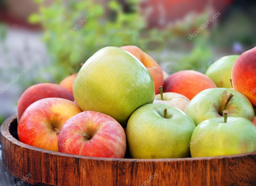 Green and red apples in wooden tray outdoor  Stock Photo #2606345