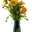 Bouquet in a blue vase — Stock Photo