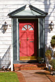 Red front door — Stock Photo