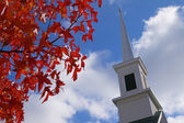 Red leaves church steeple — Stock Photo