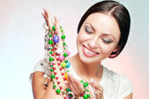 Woman with beads — Stock Photo