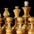 Close up of Wooden Chess Pieces on Black — Stock Photo