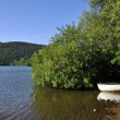Lac Chambon with small boat in France — Stock Photo